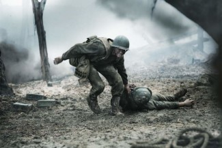 A depiction of Desmond Doss rescuing a wounded soldier from the frontline of the battle