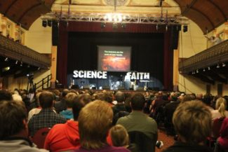 Dr. Hugh Ross speaking in 2014 to a packed Albert Hall, Launceston