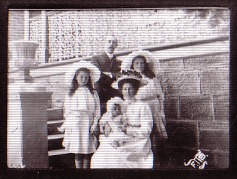 Pastor F.W. Boreham on the steps of the Hobart Baptist Manse in 1912, with Stella (his wife), and three of his children.