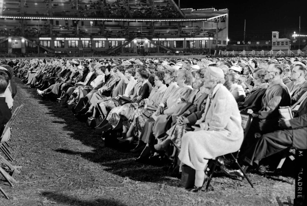 Even at night thousands of Sydney-siders braved the chill to come out to hear Billy Graham preach in the Sydney showgrounds on April 13th 1959